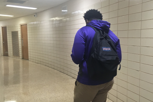 HIGH SCHOOLERS CARRY THE WEIGHT OF THE WORLD ON THEIR SHOULDERS --Senior Lee Melton walks the halls of Central High with his backpack on.