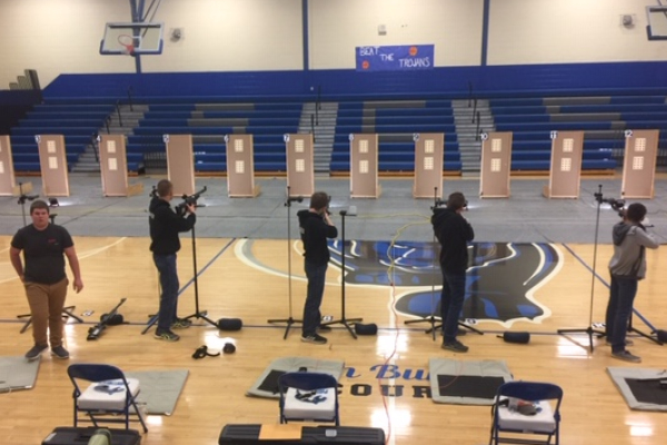 CENTRAL HIGH'S RIFLE AND ACADEMIC TEAMS SHOWCASE THEIR TALENT IN COMPETITIONS -- Rifle team competitors aim to hit the targets in order to out-do their opponents.