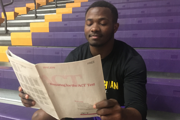 HAMILTON COUNTY PROVIDES SENIORS WITH FREE ACT PREPARATION COURSE -- Senior Michael McGhee is looking through his ACT practice booklet to review for his exam.