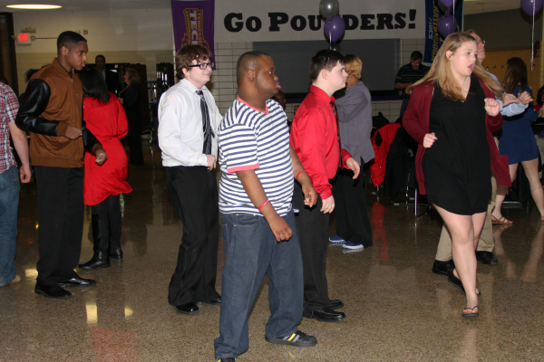 CENTRAL TO HOST ITS SIXTH ANNUAL CDC PROM WITH THE HELP OF STUDENT VOLUNTEERS -- Students dance the night away at the 2018 CDC prom, which was made possible by generous student volunteers.