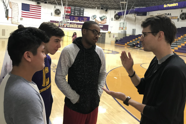 CENTRAL TRACK AND FIELD PREPARES FOR UPCOMING SEASON -- Head Coach Matthew Joyner talks to his runners in the gym before they begin workouts.