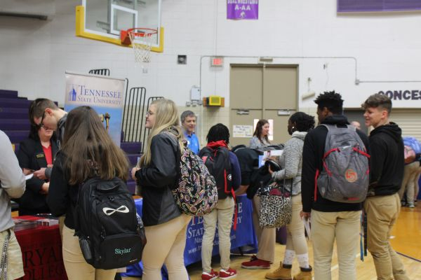 2019 CENTRAL HIGH SCHOOL COLLEGE FAIR-- Students crowd around booths to view their desired colleges.