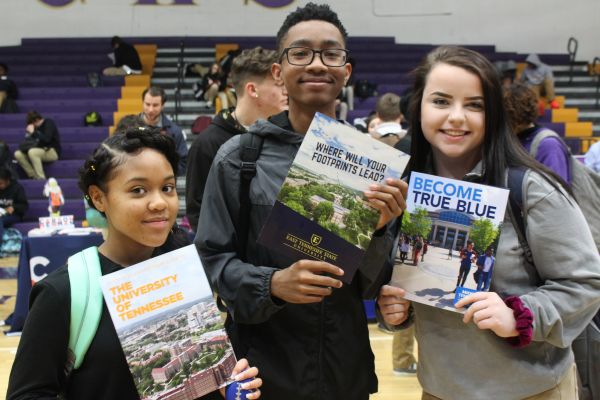 2019 CENTRAL HIGH SCHOOL COLLEGE FAIR-- Three students show off their choice colleges.