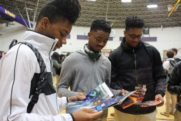 2019 CENTRAL HIGH SCHOOL COLLEGE FAIR-- Three seniors analyze brochures from their colleges of interest.