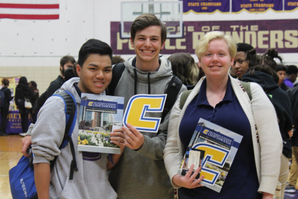2019 CENTRAL HIGH SCHOOL COLLEGE FAIR-- Three seniors pose with UTC brochures.