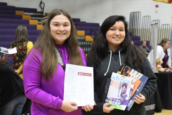 2019 CENTRAL HIGH SCHOOL COLLEGE FAIR-- Two students pose as they collect brochures for the colleges of their choice.