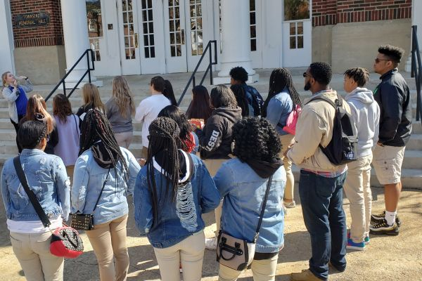 ONPOINT CLUB EMBARKS ON COLLEGE TOUR -- The OnPoint club listens to a presentation outside of Wesleyan University's library.