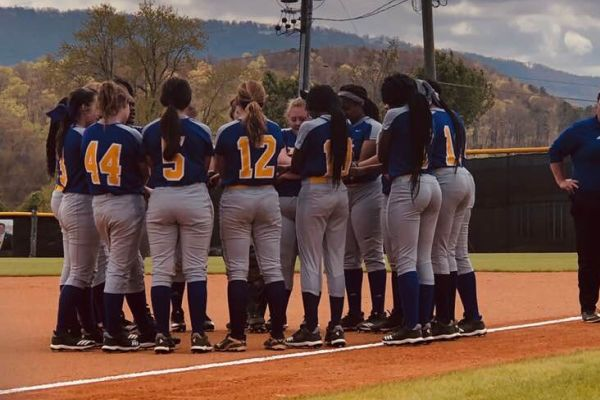 THE LADY POUNDERS PLAN TO BRING THE HEAT FOR THE UPCOMING SEASON -- The softball team huddles up in preparation of an upcoming game.