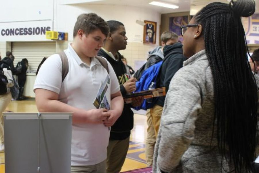 2019 CENTRAL HIGH SCHOOL COLLEGE FAIR-- A college adviser discloses details to a student.