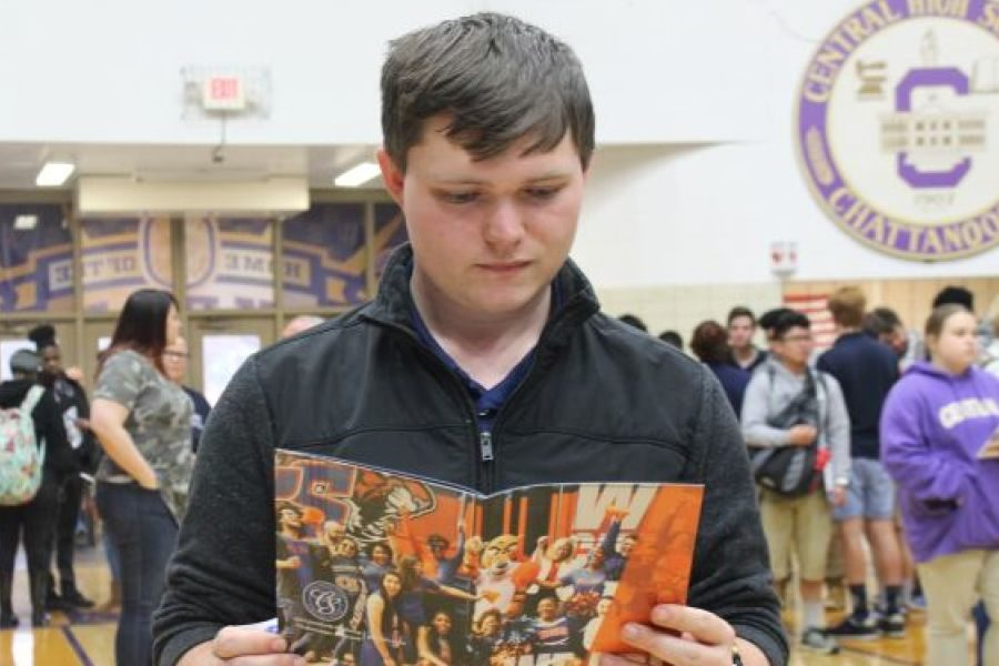2019 CENTRAL HIGH SCHOOL COLLEGE FAIR-- A senior analyzes a potential college option.