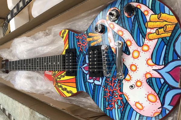 CENTRAL STUDENTS' GUITAR DESIGNS ARE ON DISPLAY IN DOWNTOWN CHATTANOOGA -- Competitor Danae Wnuk's guitar was inspired by sea life, as shown by the octopus depicted in her artwork.