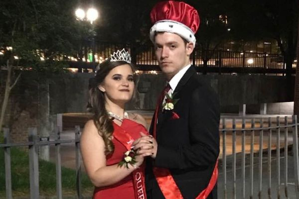THE RED CARPET: A NIGHT TO REMEMBER-- Senior prom Queen Maggie Pedigo (left) is standing next to prom King Mercer Wilky (right).