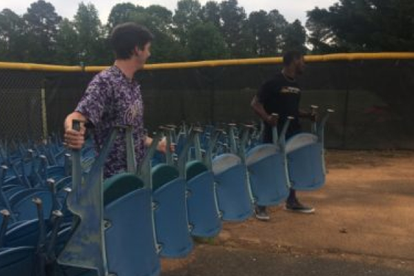 CENTRAL'S BASEBALL TEAM RECEIVES STADIUM SEATS TO IMPROVE STANDS -- Former and current players Cody Reels (left) and Michael McGhee (right) unload seats.