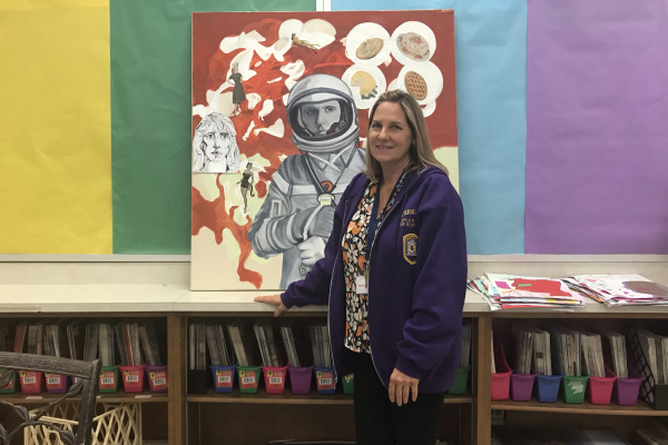 ART INSTRUCTOR MELISSA HOESMAN IS PAINTING THE PATHWAY FOR ARTISTIC NEW BEGINNINGS -- Ms. Hoesman is very excited to see what her new students can do. She models her latest art piece that centers around an astronaut.