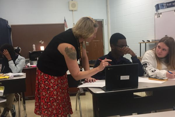 ALGEBRA I TEACHER DEE UNDERWOOD IS READY TO HELP STUDENTS REACH NEW HEIGHTS -- Here, Underwood helps out a student with work on their Chromebook.