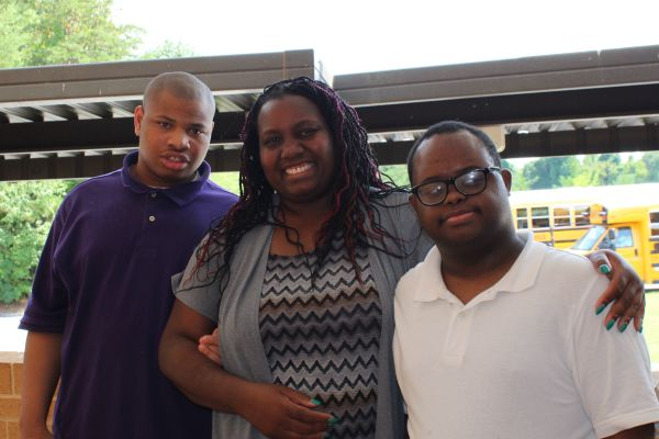 COURTNEY PARHAM JOINS THE CENTRAL FAMILY AS NEW COMPREHENSIVE PROGRAM TEACHER - - Ms Courtney Parham pictured with two of her students, Dominique Armour (left) and Pierre Joseph (right).