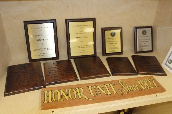 CENTRAL'S JROTC MARCHES TO SUCCESS AT ARMED FORCES DAY PARADE -- The plaques from past years' parades are on display in the Central High School armory.