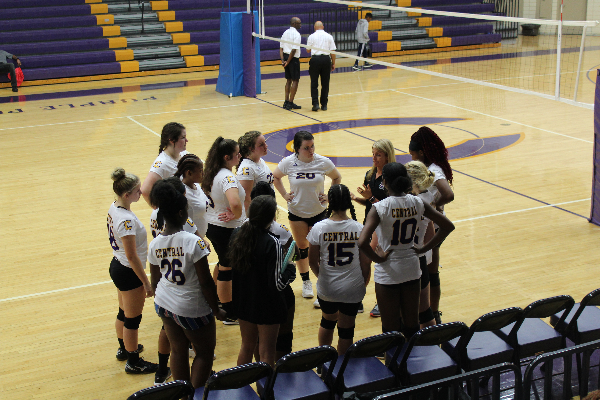 CENTRAL'S VOLLEYBALL TEAM IS SPIKING THEIR WAY INTO A NEW SEASON -- Coach Holly Ware leading her volleyball girls in a team huddle.