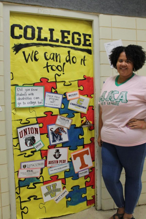COLLEGE+WEEK+2019+--Kayla+Butler+stands+beside+the+winning+door+of+college+week%2C+encouraging+college+for+all+students.+%0A%0AA+pep+rally+commenced+later+on+in+the+day+on+Friday%2C+September+20.