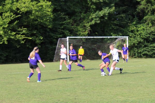 CENTRAL'S GIRLS SOCCER TEAM STRIVES FOR IMPROVEMENT DURING HIXSON HIGH SCHOOL MATCH -- Karleigh Schwarzl tries to steal the ball from a Hixson High School player.