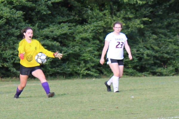 2019-2020+LADY+POUNDERS+SOCCER+--+Kassy+Griffith+is+hard+at+work+deflecting+potential+goals.