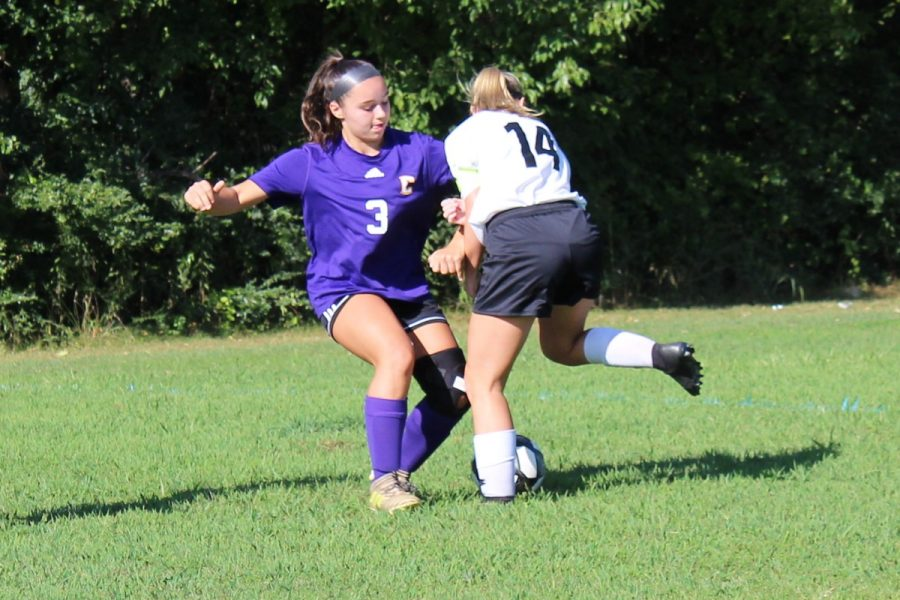 2019-2020 LADY POUNDERS SOCCER -- Karleigh Schwarzl (left) maneuvers the ball around an opponent.