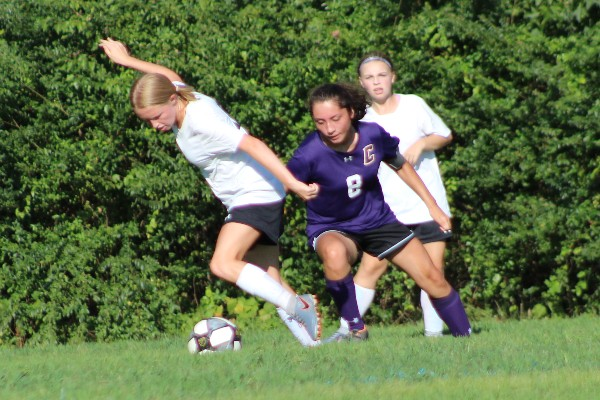 Central's Girls Soccer Team Reaches its End - - Ladies Soccer Captain, Cassandra Castillo, chases her opponent for the ball.