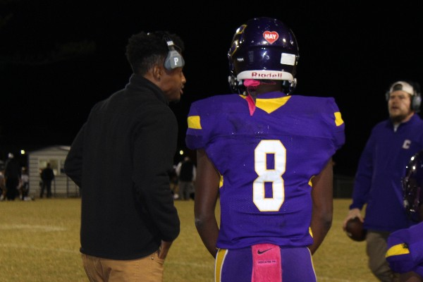 THE CENTRAL POUNDERS FIGHT HARD DESPITE LOSS AGAINST THE ANDERSON COUNTY MAVERICKS -- Senior Kelvin McGhee is talking to Coach Trey after a play.