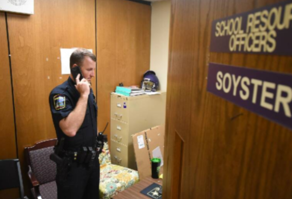 CENTRAL HIGH SCHOOL AND BROWN MIDDLE LACK FULL TIME SRO -- Officer Soyster takes a call in his office at  Central High School.