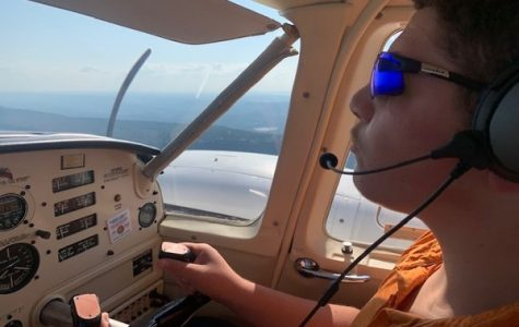 TZVI STRAUSS TAKES TO THE SKY TO PURSUE HIS DREAMS -- Central Junior Tzvi Strauss is pictured flying during an aviation lesson.