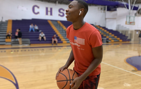 AN INSIDE LOOK AT THE UPCOMING 2019-2020 BOYS BASKETBALL SEASON -- Senior Tavarus Grayson goes to shoot a basket before his practice.