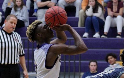 CENTRAL' S BOYS BASKETBALL LOSES AGAINST BOYD BUCHANAN BUT COMES BACK WITH A WIN AGAINST SODDY DAISY -- Senior Jokbi White, is shooting a freethrow after he is fouled in a game against Soddy Daisy High School.