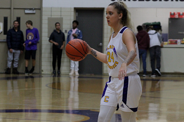 CENTRAL'S GIRLS BASKETBALL TEAM DEFEATED BY BOYD BUCHANAN AND SODDY DAISY  -- Senior Bri Ladd is dribbling the ball down the court looking for an open pass.