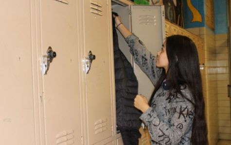 PRINCIPAL PHIL IANNARONE EXPLAINS THE NEW LOCKER POLICY -- All students were assigned a locker to store out-of-dress-code items; students are adjusting to the new policy. Senior Danae Wnuk is depicted using her locker.