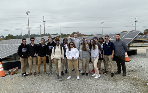 ADVANCED STUDIES STUDENTS TOUR EPB SOLAR SHARE -- The attending gifted students stand with Mr. Adam Fletcher in front of solar panels at the EPB Solar Share site.