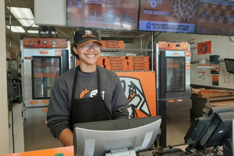 STOP KILLING TIME, MAKE IT WORK FOR YOU INSTEAD -- Central Senior Jazmynn Ball is smiling behind the registers at Little Caesars, where she works part-time.
