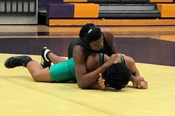 CENTRAL'S WRESTLING TEAM TAKES ON EAST HAMILTON -- Central's wrestling team fights hard during a recent match.