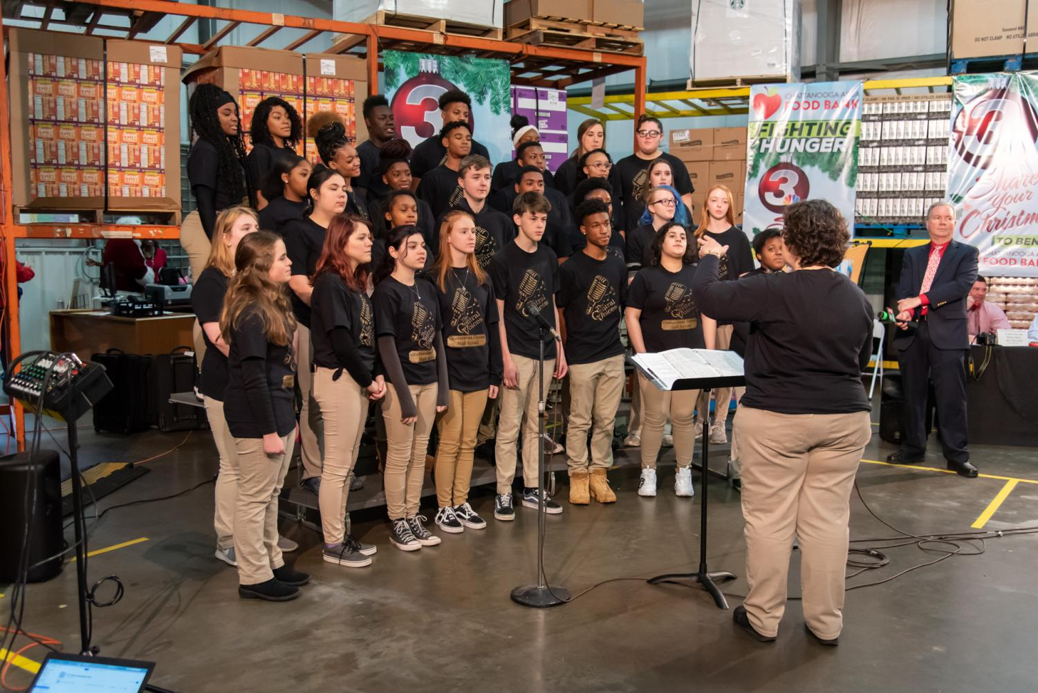 The Central Voices sing at the food bank.