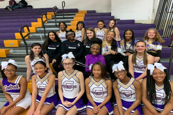 JUNIOR VARSITY CHEER SQUAD REVS UP POUNDER SPIRIT-- The junior varsity cheerleading team poses at a recent home basketball game.