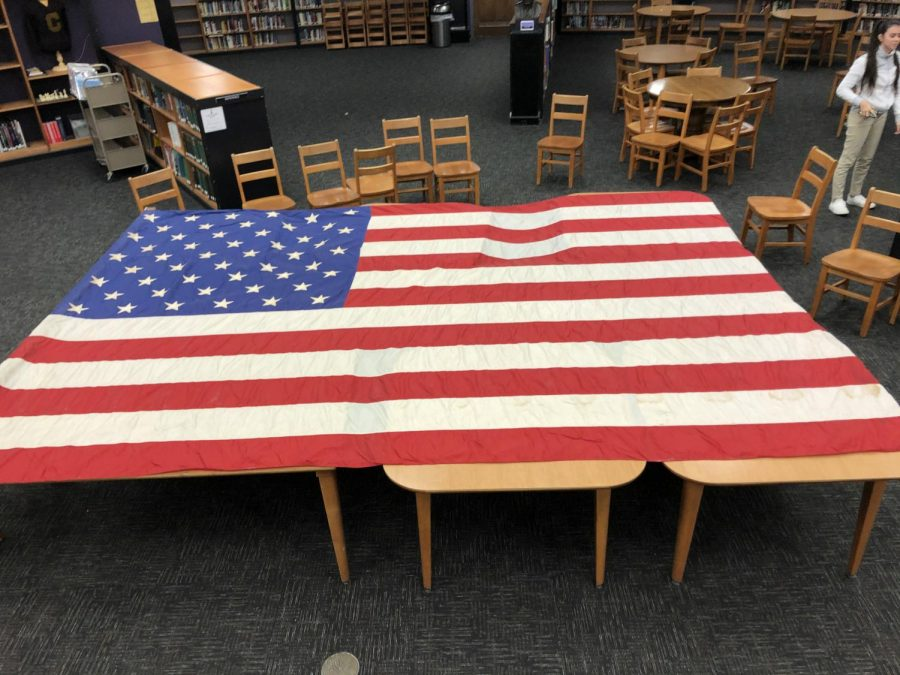 1963 FLAG IS FOUND, REPRESENTING PEAK OF CENTRAL PATRIOTISM -- The flag from the original location of Central high School, on Dodds Avenue, sits unfurled in the school library.