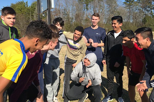 BOYS SOCCER AIMS FOR A SEASON FULL OF VICTORY -- The team gathers as Captain Patrick Quinn talks to them before practice.