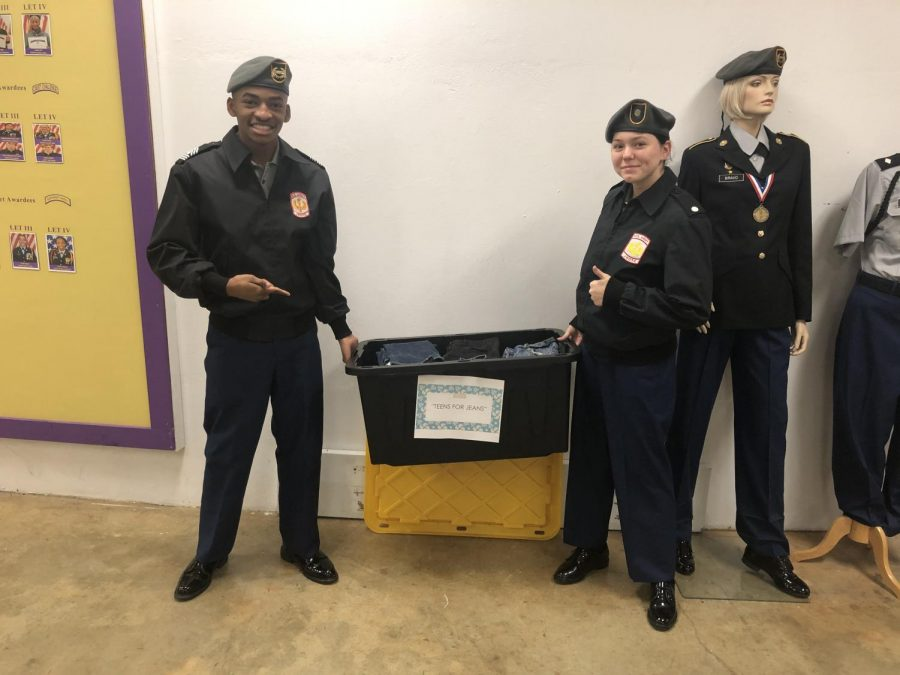 ROTC STUDENTS ORGANIZE CLOTHES DONATION FOR HOMELESS TEENS -- Two cadets hold up the collection bin full of donated jeans.