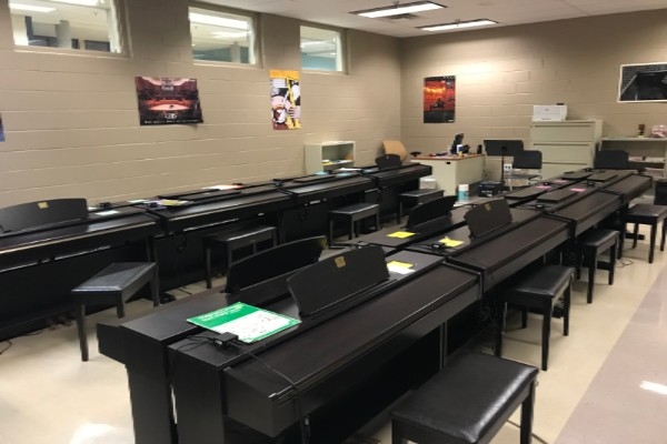 LATHAM INTRODUCES A POSSIBLE PIANO CLASS TO CENTRAL HIGH -- The Piano Lab located at East Hamilton High School.