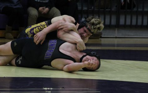 CENTRAL'S WRESTLING POUNDERS PERSIST TO VICTORY -- Previous matches have shown promise to seniors wanting to wrestle in the state tournament.