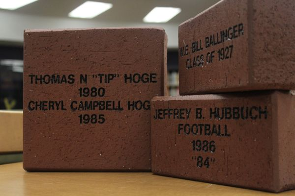 ALUMNI ASSOCIATION'S BRICK SALE CONTINUES -- The first bricks that have been ordered sit in the Central High School library.