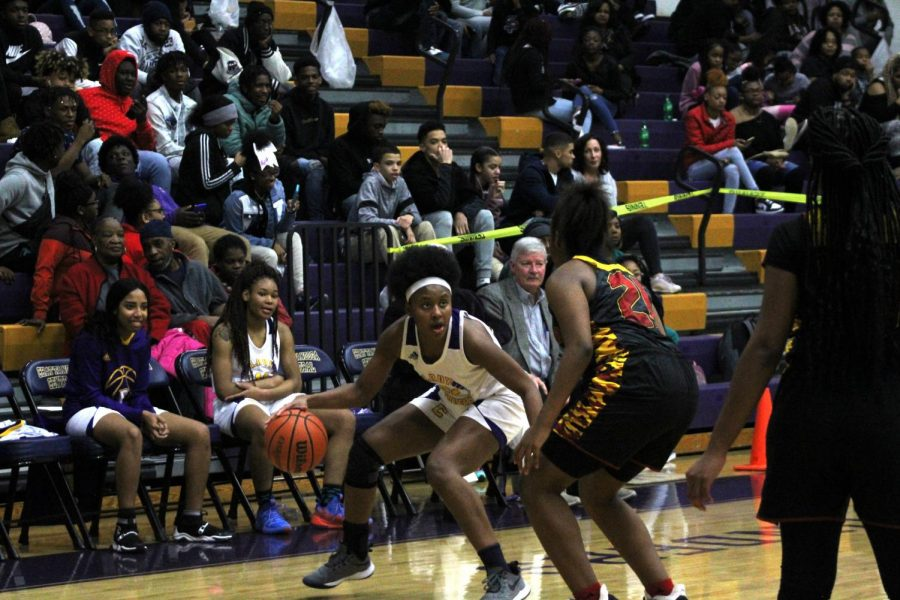 GIRLS BASKETBALL MAKES A COMEBACK WITH VICTORIES AGAINST EAST RIDGE AND HOWARD -- Sophomore Alona Allen battles against Howard player as she approaches the net.