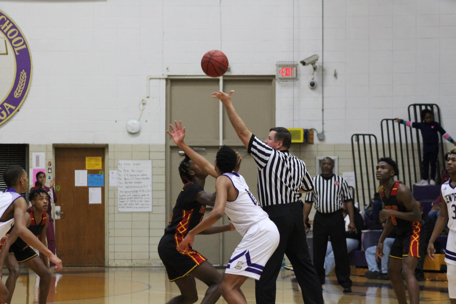 CENTRAL HIGH'S BOYS BASKETBALL IMPROVES AS THE 2019-2020 SEASON PROGRESSES -- Senior Alfonso Few lines up for a jump ball.