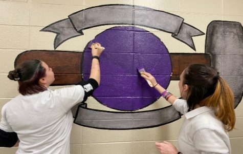 Art Students Paint Basketball Mural In Boys' Locker Room