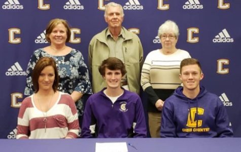 KAIGEN MULKEY SIGNS TO UTC ON A CROSS COUNTRY SCHOLARSHIP -- Kaigen Mulkey accepts his cross country scholarship.