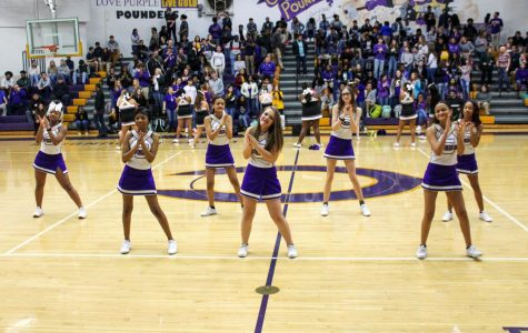 PHOTO GALLERY: 2020 FEBRUARY PEP-RALLY —Junior Varsity  cheerleaders participate in cheers facing the freshmen and sophomore side of the gym.